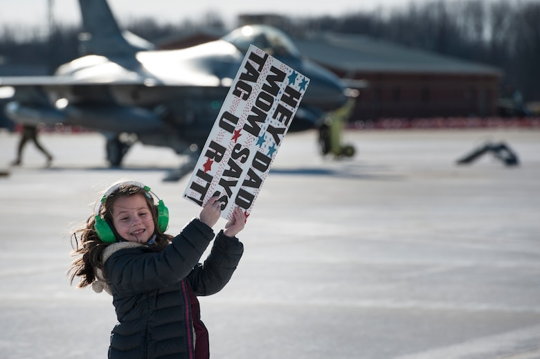 The daughter of a U.S. Air Force F-16 Fighting Falcon pilot, assigned to the Ohio National Guard's 180th Fighter Wing, waits to greet her father following a three-month Aerospace Expeditionary Force deployment to Bagram Air Base, Afghanistan, Jan. 23, 2021.