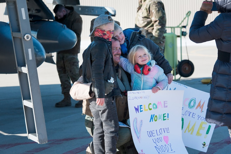 U.S. Air Force F-16 Fighting Falcon pilot, Lt. Col. Brian Moran, assigned to the Ohio National Guard's 180th Fighter Wing, greets his family for the first time after returning home from a three-month Aerospace Expeditionary Force deployment to Bagram Air Base, Afghanistan, Jan. 23, 2021.