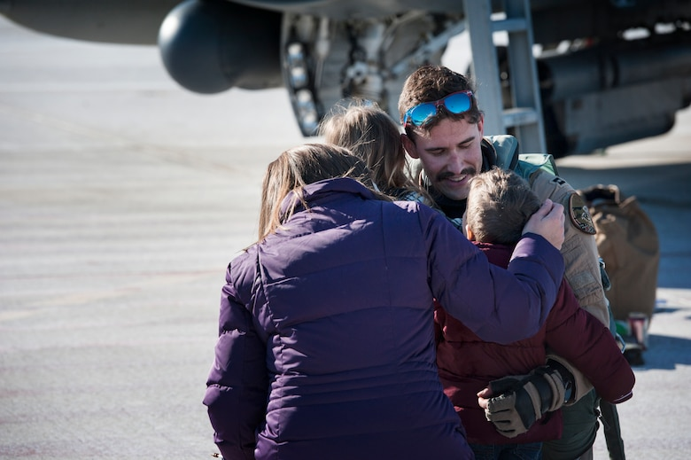 U.S. Air Force F-16 Fighting Falcon pilot, Capt. William Ross, assigned to the Ohio National Guard's 180th Fighter Wing, greets his family for the first time after returning home from a three-month Aerospace Expeditionary Force deployment to Bagram Air Base, Afghanistan, Jan. 23, 2021.