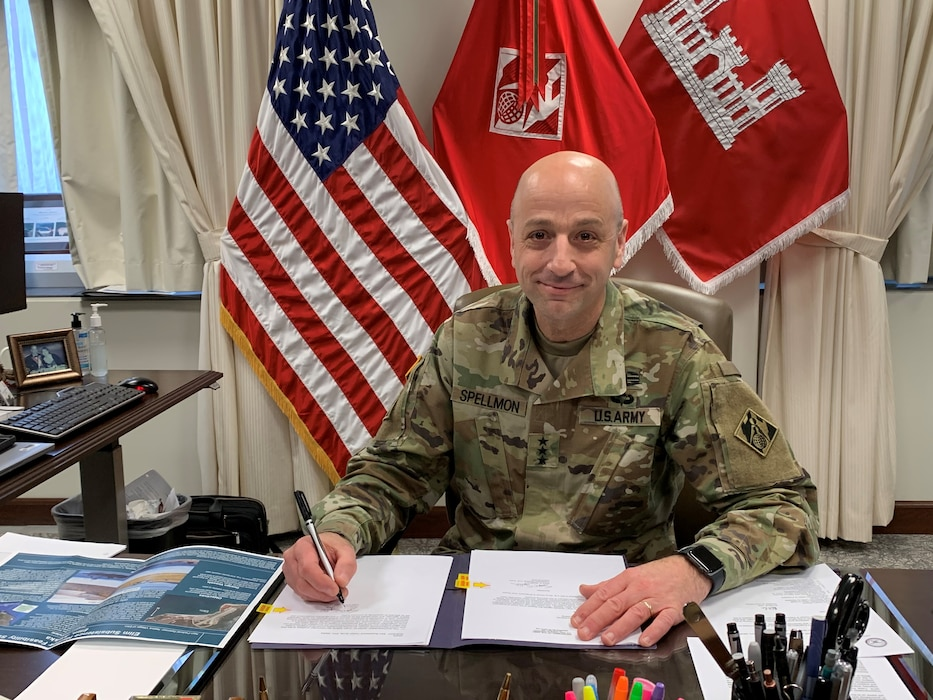LTG Spellmon signs the Chief's Report for the Elim Subsistence Harbor in Alaska.
