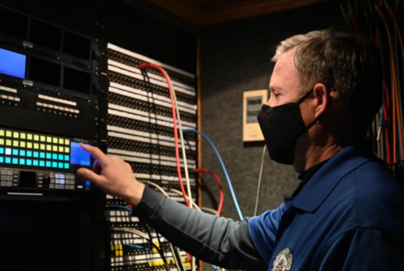 A man works with network gear.