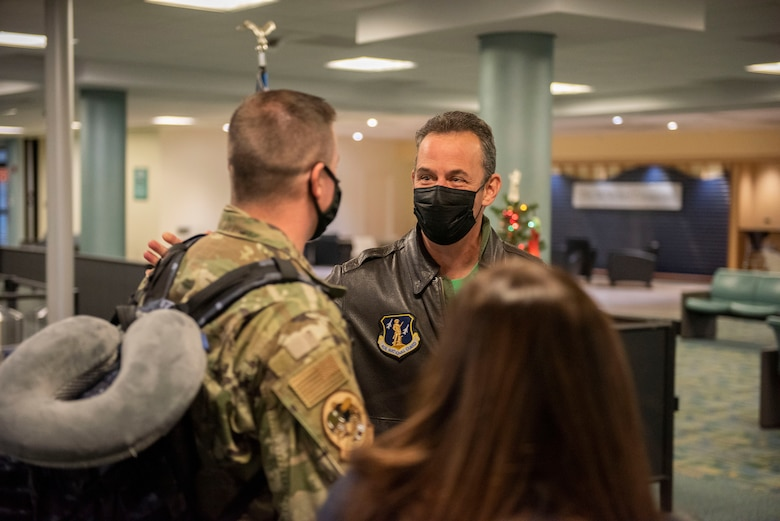 U.S. Air Force Col. Michael DiDio, Commander of the Ohio National Guard's 180th Fighter Wing, welcomes an Airman home after returning from an overseas deployment, Dec. 31, 2020 at the Eugene F. Kranz Toledo Express Airport.