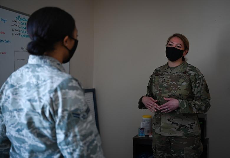 U.S. Air Force Airman 1st Class Tori Turner, a 354th Communication Squadron (CS) knowledge management technician, talks to Chief Master Sgt. Bridget Bruhn, the 354th CS superintendent, at Eielson Air Force Base, Alaska, March 22, 2021