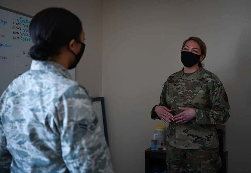 U.S. Air Force Airman 1st Class Tori Turner, a 354th Communication Squadron (CS) knowledge management technician, talks to Chief Master Sgt. Bridget Bruhn, the 354th CS superintendent, at Eielson Air Force Base, Alaska, March 22, 2021