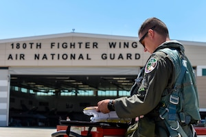 U.S. Air Force 1st Lt. T.J. Copic, an F-16 Fighting Falcon pilot assigned to the Ohio National Guard's 180th Fighter Wing, prepares for a training flight at the 180FW in Swanton, Ohio, June 30, 2020.