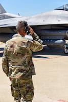 U.S. Air Force Master Sgt. Terry Copic, a crew chief assigned to the 113th Wing, D.C. Air National Guard, launches an F-16 Fighting Falcon, assigned to the Ohio National Guard's 180th Fighter Wing, piloted by his nephew, 1st Lt. T.J. Copic, an F-16 fighter pilot assigned to the 180FW, for a training flight at the 180FW in Swanton, Ohio, June 30, 2020.
