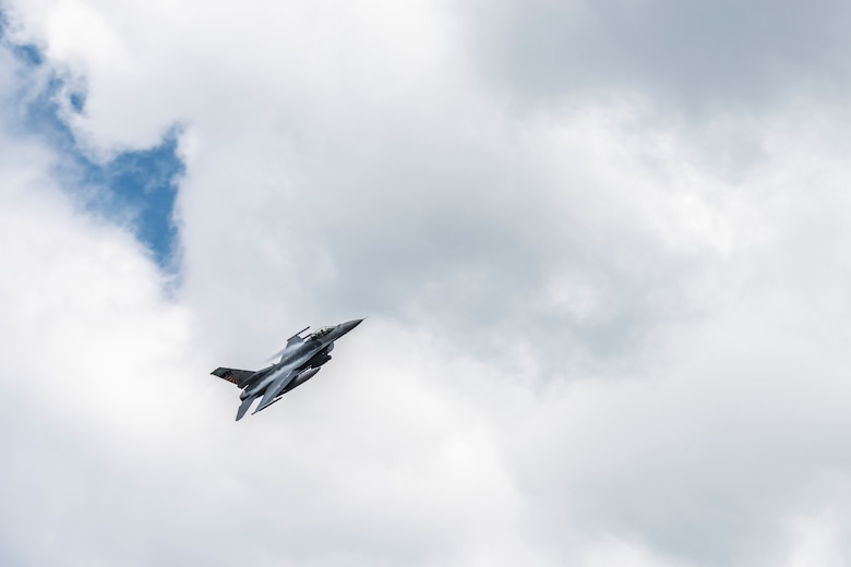 A U.S. Air Force F-16 Fighting Falcon, assigned to the Ohio National Guard's 180th Fighter Wing, flies over the 180FW during a training flight in Swanton, Ohio, Aug. 6, 2020.