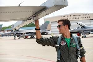 U.S. Air Force Captain William Ross, an F-16 Fighter Pilot assigned to the Ohio National Guard's 180th Fighter Wing, conducts a pre-flight inspection of an F-16 Fighting Falcon before a training flight at the 180FW in Swanton, Ohio, July 30, 2020.