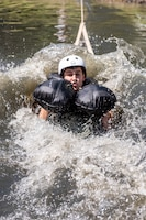 U.S. Air Force Capt. Robert Lowery, an F-16 fighter pilot assigned to the Ohio National Guard's 180th Fighter Wing, is dragged through the water during water survival training in Waterville, Ohio, Aug. 8, 2020.