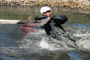 U.S. Air Force Lt. Col. Brian Cherolis, an F-16 fighter pilot assigned to the Ohio National Guard's 180th Fighter Wing is dragged through the water during water survival training in Waterville, Ohio, Aug. 8, 2020.