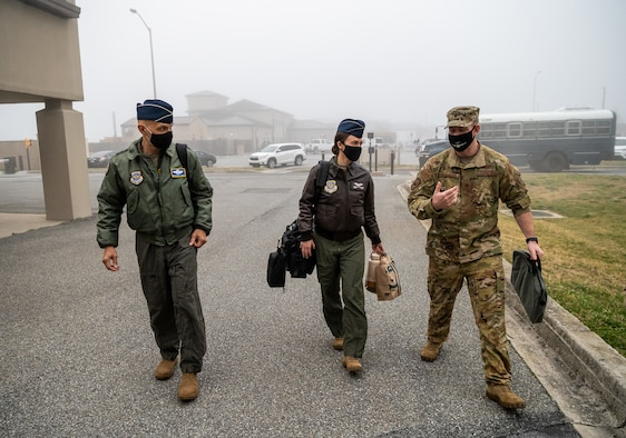 From left, U.S. Air Force Airmen Lt. Gen. Brian Robinson, Air Mobility Command deputy commander, Capt. Kaitlyn Tinkham, AMC executive officer to the deputy commander, and Maj. Steven Beachler, 3rd Airlift Squadron pilot, walk to the base operations building prior to a flight at Dover Air Force Base, Delaware, March 23, 2021. Robinson visited Dover AFB to engage with base leaders and fulfill training requirements on the C-17 Globemaster III. (U.S. Air Force photo by Senior Airman Christopher Quail)