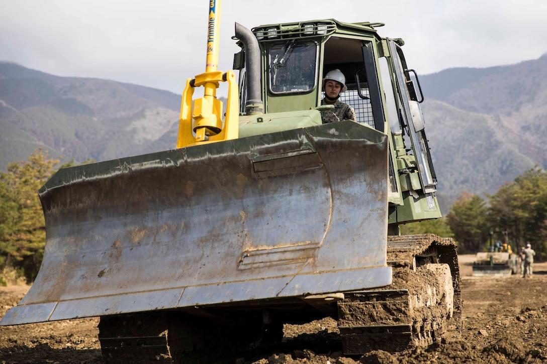 A Marine operates heavy construction equipment.