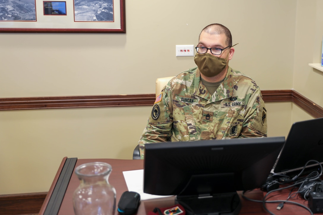 U.S. Army Reserve Sgt. 1st Class Alexander L. Duncan, noncommissioned officer in charge for the U.S. Army Civil Affairs and Psychological Operations Command (Airborne) Strategic Initiatives Group (SIG), coordinates technical support for the USACAPOC(A) Fiscal Year 2022 Training Brief (YTB), March 23 - 26 2021, Ft. Bragg, N.C. The FY22 YTB is an annual event hosted by USACAPOC(A) for commanders from subordinate elements to brief training concepts, philosophies and challenges during the socially distant, protective measured YTB at the USACAPOC(A) headquarters at Ft. Bragg, N.C.