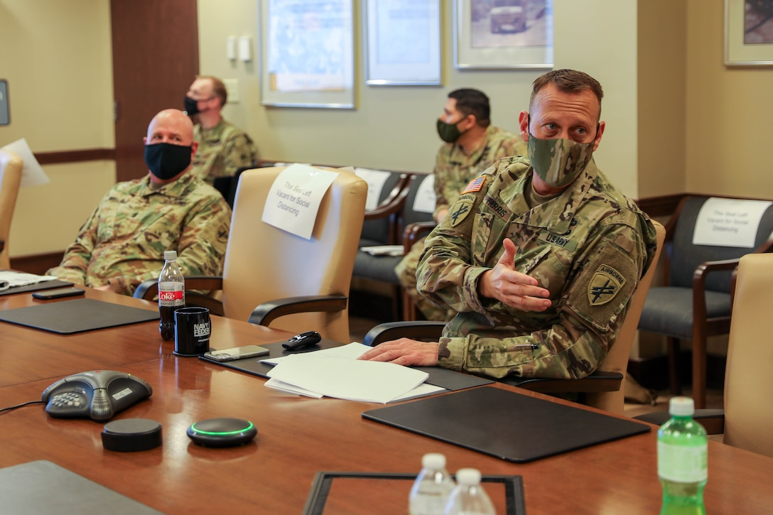 Commanding General of the 352nd Civil Affairs Command, Brig. Gen. Jeffrey M. Farris (right), with Command Sgt. Maj. Michael R. Mielke (left), senior enlisted advisor for the 352nd CACOM, conducts a portion of the Fiscal Year 2022 Training Brief (YTB) to the Commanding General of the U.S. Army Civil Affairs and Psychological Operations Command (Airborne), Brig. Gen. Jeffrey C. Coggin, March 23 - 26 2021, Ft. Bragg, N.C. The FY22 YTB is an annual event hosted by USACAPOC(A) for commanders from subordinate elements to brief training concepts, philosophies and challenges during the socially distant, protective measured YTB at the USACAPOC(A) headquarters at Ft. Bragg, N.C.