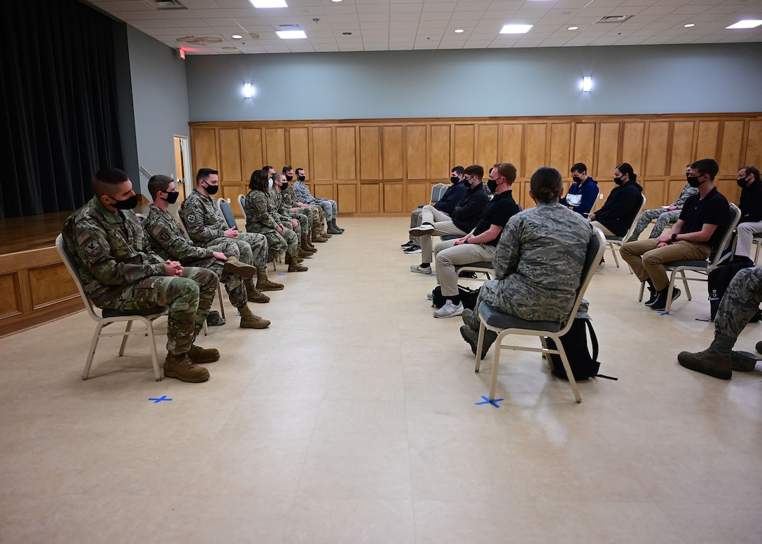 ROTC cadets ask questions during a panel discussion