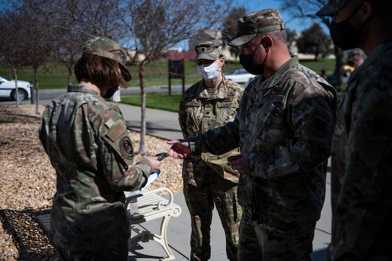 Chief Master Sgt. of the Air Force JoAnne Bass, left, receives a 9th Physiological Support Squadron (PSPTS) patch from 9th PSPTS leadership on Beale Air Force Base.