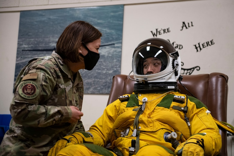 Chief Master Sgt. of the Air Force JoAnne Bass, left, communicates with a 9th Physiological Support Squadron airman who was demonstrating the pressure suit worn by U-2 Dragonlady pilots on Beale Air Force Base.