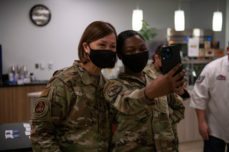 Chief Master Sgt. of the Air Force JoAnne Bass, left, takes a photo with an airman on Beale Air Force Base.