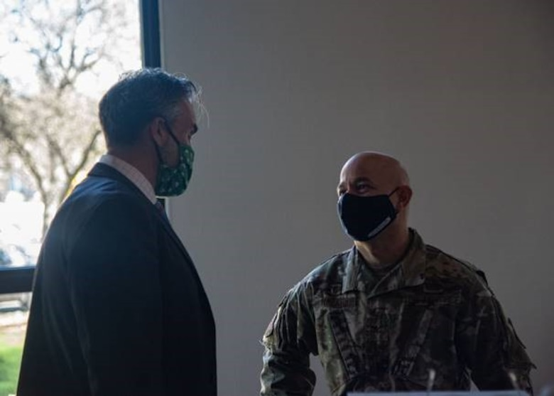 U.S. Air Force Col. Andres Nazario, 17th Training Wing commander, talks to Chamber of Commerce Chairman of the Board, Shane Plymell, at the monthly Chamber of Commerce address, held at the Bentwood Country Club, in San Angelo, Texas, March 23, 2021. At this event, Nazario highlighted his thankfulness for community partnerships and the support given by the city of San Angelo. (U.S. Air Force photo by Staff Sgt. Tyrell Hall)