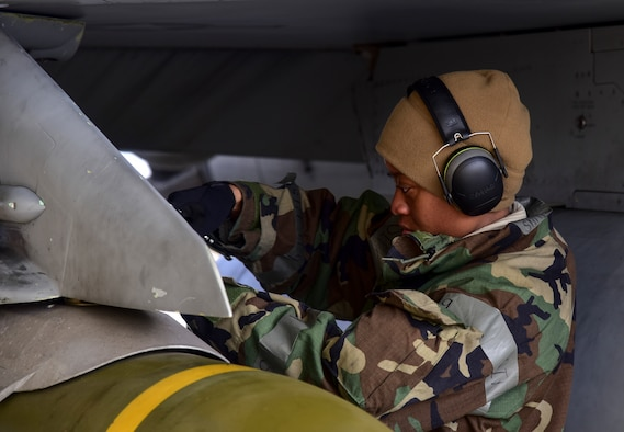 Staff Sgt. Samill Harkness, 35th Aircraft Maintenance Unit load crew member, tightens bolts while turning jets at Kunsan Air Base, Republic of Korea, March 23, 2021. During a routine training event, F-16 Fighting Falcons landed and quickly refueled before taking off for another sortie. (U.S. Air Force photo by Tech. Sgt. Kristin S. High)