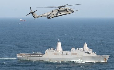 A U.S. Marine Corps CH-53E Super Stallion helicopter flies above USS San Diego (LPD 22).