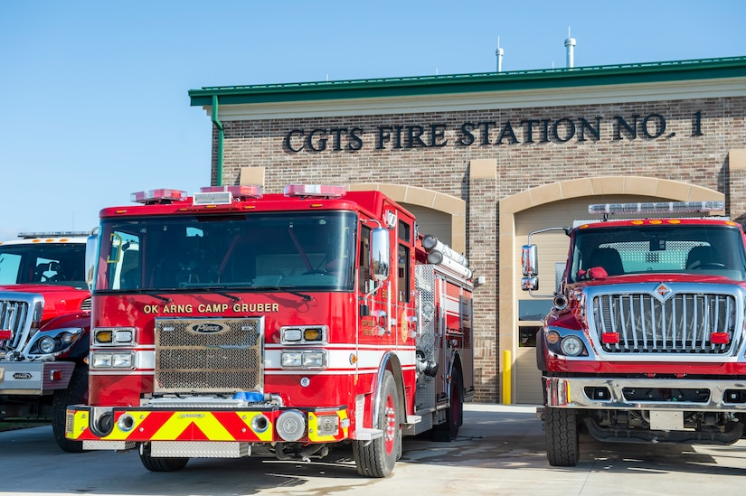 Fire trucks assigned to the newly opened Fire Station Number 1 sit parked outside the station prior to a ribbon cutting at Camp Gruber Training Center, March 24, 2021. (Oklahoma Army National Guard photo by Anthony Jones)