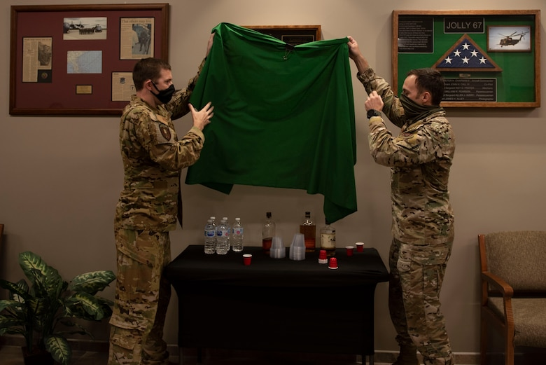 A photo of two U.S. Air Force commanders unveiling a shadowbox.