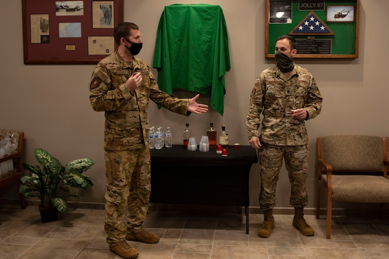 A photo of two U.S. Air Force commanders preparing a toast.