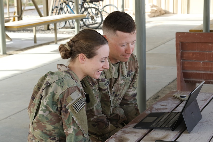 Cpl. Ashley Hibbler, left, and Spc. Kyle Hibbler, deployed with Delta Company, 2-104th General Support Aviation Battalion, 28th Expeditionary Combat Aviation Brigade, video chat with their 3-year-old son Landon from an airfield in the 28th ECAB's area of operations in the Middle East.