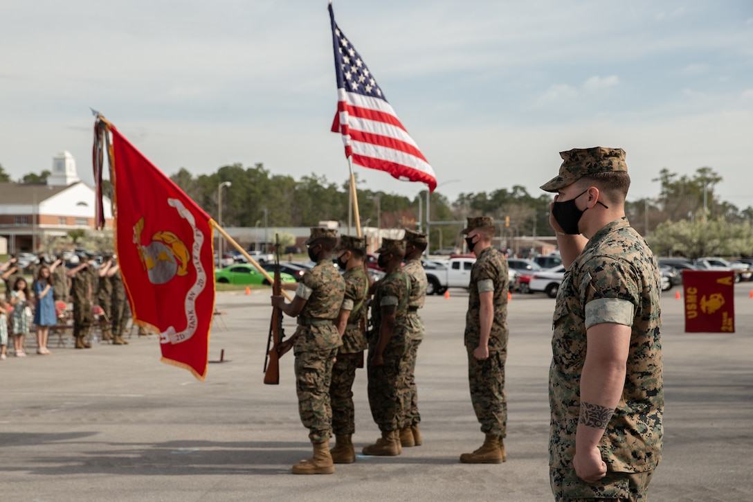 U.S. Marine Corps Sgt. Hunter Miller, a motor vehicle operator with Alpha Company, 2d Tank Battalion, 2d Marine Division, salutes during a deactivation ceremony on Camp Lejeune, N.C., March 25, 2021. Alpha Co. served 2d MARDIV for nearly 80 years and participated in numerous conflicts and operations throughout that period. The deactivation is in accordance with the force-wide modernization efforts that will make the USMC more competitive to fight a peer or near-peer threat. (U.S. Marine Corps photo by Lance Cpl. Jennifer E. Reyes)