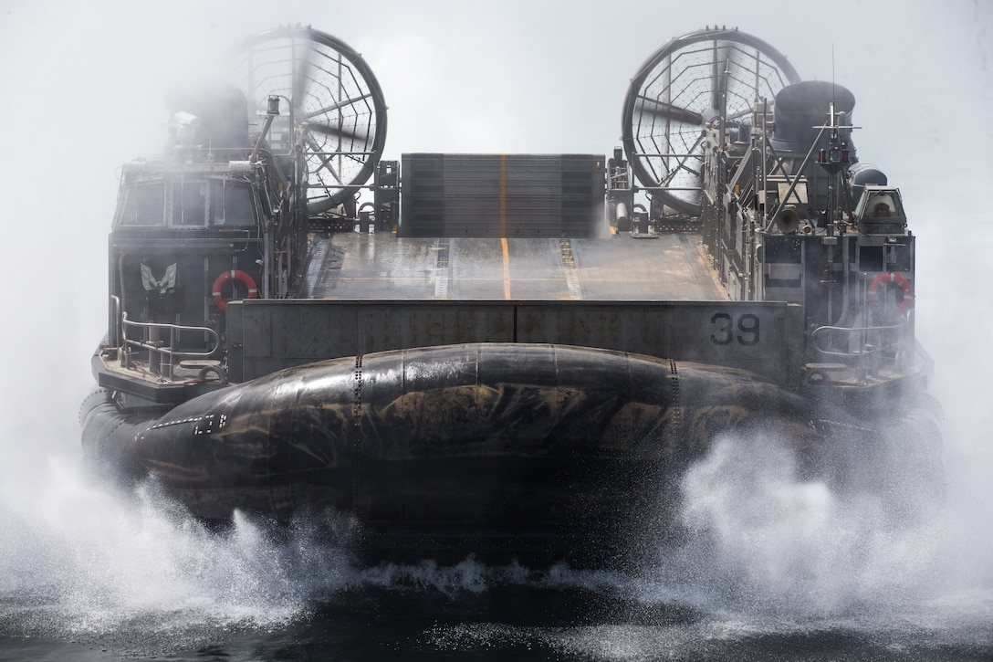 GULF OF OMAN (March 23, 2021) – U.S. Navy Landing Craft, Air Cushion 39, attached to Assault Craft Unit 5, returns to the amphibious transport dock ship USS Somerset (LPD 25) after disembarking personnel and equipment assigned to the 15th Marine Expeditionary Unit (MEU), in the Gulf of Oman, March 23. Somerset, part of the Makin Island Amphibious Ready Group, and the 15th MEU are deployed to the U.S. 5th Fleet area of operations in support of naval operations to ensure maritime stability and security in the Central Region, connecting the Mediterranean and Pacific through the western Indian Ocean and three strategic choke points. (U.S. Marine Corps photo by Lance Cpl. Brendan Mullin)