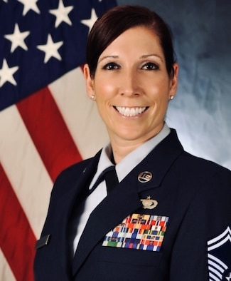 U.S. Air Force Senior Master Sgt. Tracy Bennett, 435th Air Expeditionary Wing senior enlisted leader and superintendent of expeditionary manpower and organization, poses in an official photo, Ramstein Air Base, Germany, March 23, 2021. Bennett's duties include evaluating expeditionary organization structures for effectiveness and efficiency by studying the organization's mission, structure and workload. As a senior enlisted leader, Bennett is the liaison between the enlisted force and the director of staff. Her goals are to finish her Masters of Business Administration, retire from the Air Force and travel the world. (Courtesy Photo)