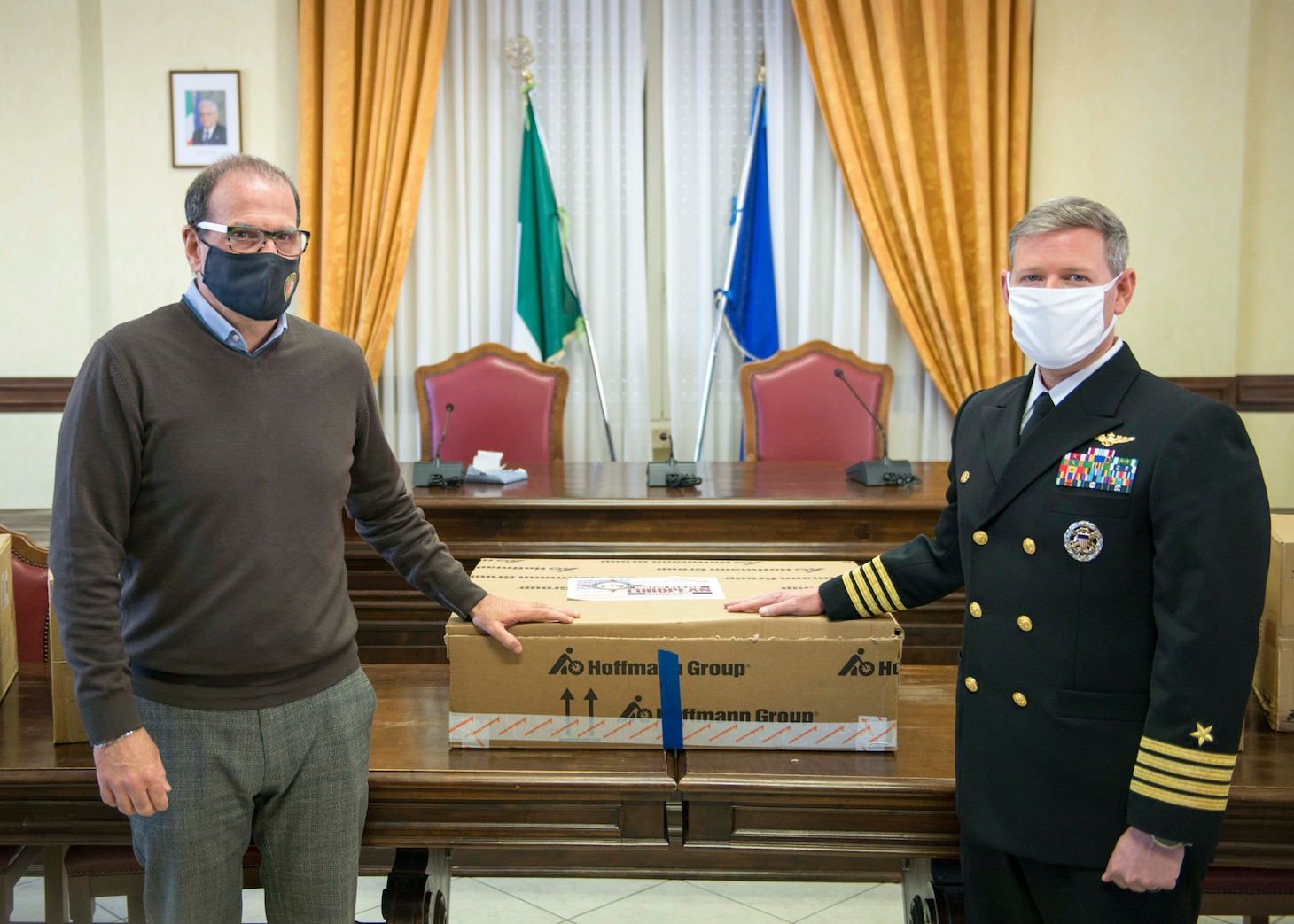 Capt. David Pollard, Commanding officer of the Blue Ridge-class command and control ship USS Mount Whitney, and Cosmo Mitrano, mayor of Gaeta, Italy, pose for a photo during a medical supplies donation to Gaeta, Italy on behalf of the USS Mount Whitney (LCC 20) in Gaeta, March 26, 2021.