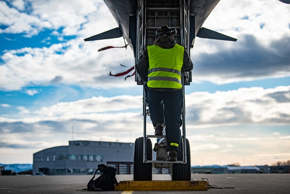 A crew chief assigned to the 9th Expeditionary Bomb Squadron services the landing gear on a B-1B Lancer at Ørland Air Force Station, Norway, March 13, 2021. Aircraft maintainers service the landing gear tires to ensure they are at the proper pounds per square inch needed to safely land the aircraft. (U.S. Air Force photo by Airman 1st Class Colin Hollowell)