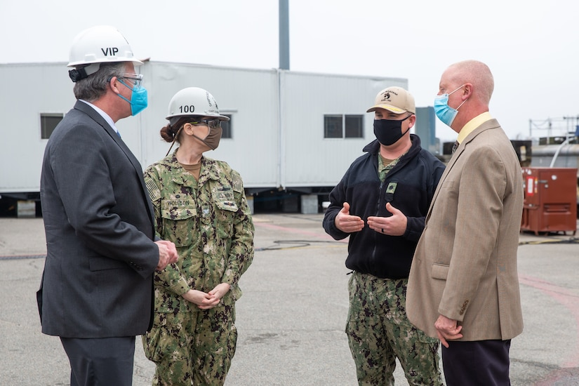 Acting Secretary of the Navy Thomas W. Harker stops at Dry Dock 4 during his visit to Norfolk Naval Shipyard March 17. Dry Dock 4 is undergoing a $200 million renovation spanning nearly three years as part of the Shipyard Infrastructure Optimization Program (SIOP) modernizing the nation's public shipyards. Secretary Harker toured NNSY as part of a visit to the Mid-Atlantic region.