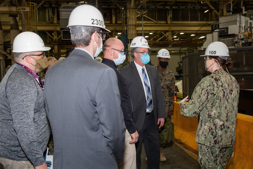Acting Secretary of the Navy Thomas W. Harker visits the Production Machine Shop during his tour of Norfolk Naval Shipyard March 17. Secretary Harker toured NNSY as part of a visit to the Mid-Atlantic region.