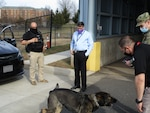 (U) Director Scolese plays with Max, one of SOD's two canine inspectors.