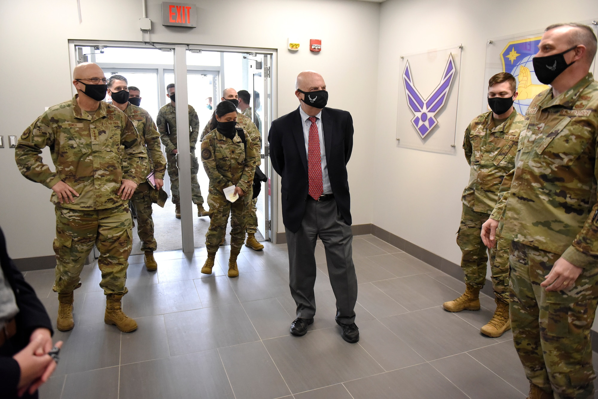 Acting Secretary of the Air Force John Roth greets Air Force personnel with the National Air and Space Intelligence Center at Wright-Patterson Air Force Base, Ohio, March 23, 2021.  Roth met with Air Force personnel and toured several facilities at the base including the U.S. Air Force School of Aerospace Medicine Epidemiology Laboratory, which is responsible for analyzing a majority of the COVID-19 tests in the Air Force. (U.S. Air Force photo by Ty Greenlees)
