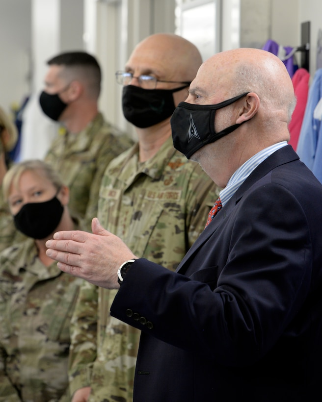 Acting Secretary of the Air Force John Roth, right, and Gen. Arnold W. Bunch Jr., commander, Air Force Materiel Command, listen to a presentation about the U.S. Air Force School of Aerospace Medicine Epidemiology Laboratory at Wright-Patterson Air Force Base, Ohio, March 23, 2021. The lab is responsible for analyzing a majority of the COVID-19 tests in the Air Force. Roth met with Air Force personnel and toured several facilities at the base including the National Air and Space Intelligence Center. (U.S. Air Force photo by Ty Greenlees)