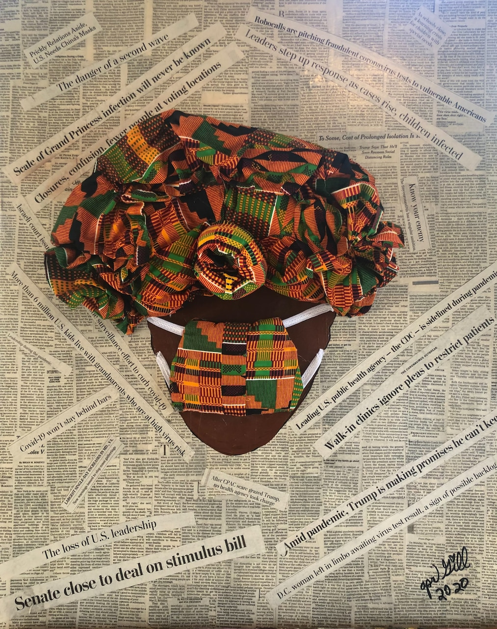 An African-inspired fabric headwrap and mask sits atop a mashup of newspaper articles and headlines.