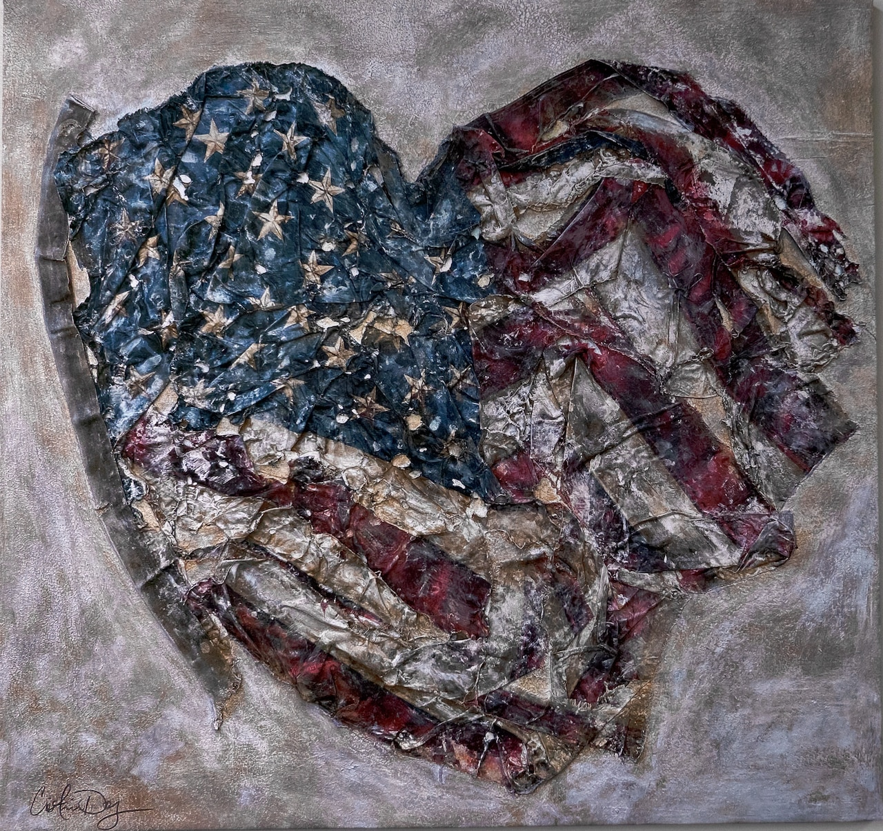 A painting depicts an American flag crinkled into the shape of a heart.