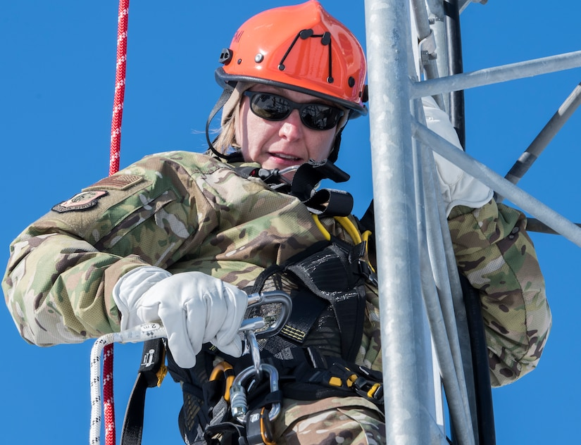 U.S. Air Force Col. Kirsten Aguilar, Joint Base Elmendorf-Richardson and 673d Air Base Wing commander, climbs an antenna during a 673d Communications Squadron immersion tour at JBER, Alaska, March 19, 2021. The focus of Aguilar's tour was to get to know the 673d CS Airmen and familiarize herself with the squadron's different sections and each one's role in supporting the base.