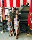 U.S. Marine Corps Gunnery Sgt. Sean Curb, the station commander of Recruiting Substation Houma, Recruiting Station Baton Rouge, poses with his family following his promotion ceremony at the Regional Military Museum in New Orleans, La., October 1, 2019. (Courtesy photo)