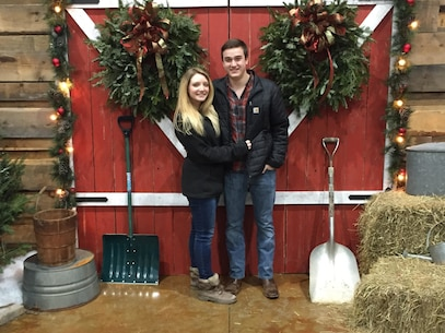 David (right) and Brianna (left) Whitehead pose in front of a barn at a Christmas market in Marietta, Ga. (U.S. Marine Corps courtesy photo)