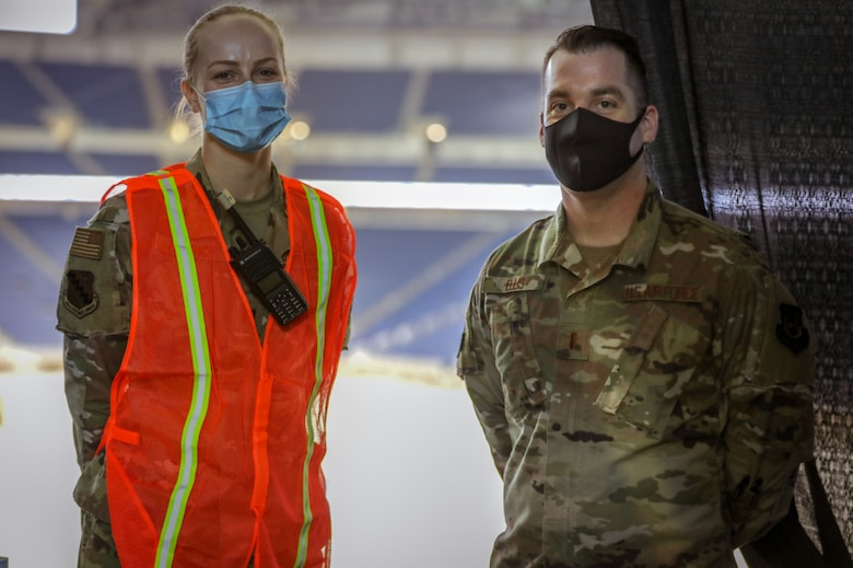 Capt. Victoria Zenyuch,and 2nd Lt. Christopher Ellis, a registered nurse and administration officer from the 66th Medcical Squadron at Hanscom Air Force Base, Mass., pose, during a break at the state-led, federally-supported Ford Field COVID-19 Community Vaccination Center in Detroit, March 24. The 66 MDS deployed a team of medics to Detroit in support of the federal effort to vaccinate up to 6,000 people a day against COVID-19. (U.S. Army photo by Spc. Laurie Ellen Schubert)