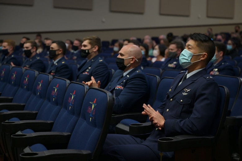 Student pilots of Specialized Undergraduate Pilot Training class 21-07 clap for the commencement of the graduation ceremony, March 26, 2021, on Columbus Air Force Base, Miss. To earn Air Force wings, each student flies nearly 200 hours during a 54-week period. (U.S. Air Force photo by Senior Airman Jake Jacobsen)