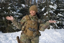 U.S. Air Force Senior Airman Heaven Fisher, a 354th Security Forces Squadron response force leader, poses for a photo March 16, 2021, on Eielson Air Force Base Alaska. Fisher is a single parent and utilizes various childcare programs in order to serve in the Air Force without worrying about her child's well-being. (U.S. Air Force photo by Senior Airman Beaux Hebert)
