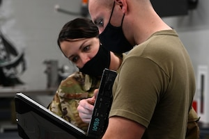 egress section performs maintenance on ejection seat