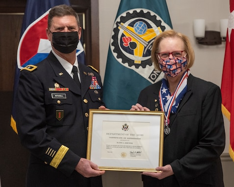 K Krewer, chief counsel, U.S. Army Materiel Command Legal Center-Rock Island Arsenal, was honored for her career accomplishments during a retirement ceremony held here, March 26.