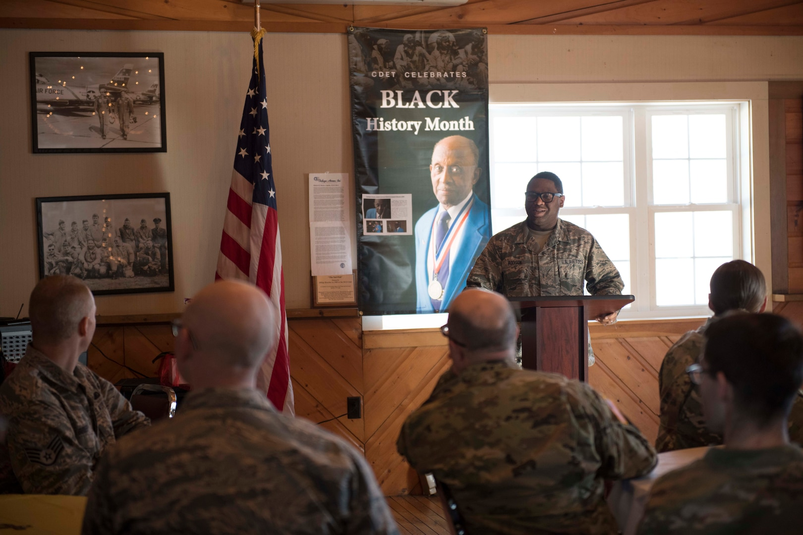 U.S. Air Force Technical Sgt. Kirby Addison opens a luncheon with a few words at the Vermont Air National Guard base Feb. 14, 2019. The Cultural Diversity Enhancement Team of the Vermont National Guard hosted a soulful luncheon and discussion for Airmen and Soldiers with a focus on Black History Month and included a guest speaker. (U.S. Air National Guard photo by 2nd Lt. Chelsea Clark)